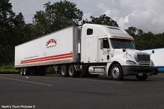 Central Refrigerated White Freightliner parked at a truck stop