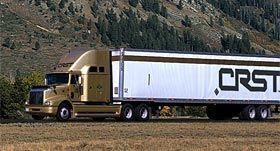CRST truck driving through mountains