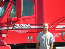 Roehl Driver Trainer next to truck
