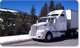 USA Truck along snowy mountains